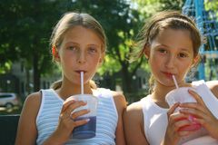Girls With Takeout Drinks Royalty Free Stock Images