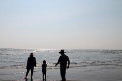 Girls, woman and man watching. Girls, women and men  enjoying holiday at beach Royalty Free Stock Images