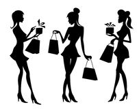 Girls and women with shopping bags Royalty Free Stock Images