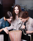 Girls wonder the purchases Stock Image