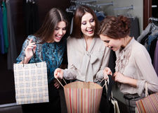 Girls wonder the purchases of their girlfriend Royalty Free Stock Photography