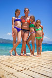 Girls on the wooden pier on the sea Stock Photo