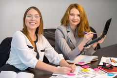 Portrait of two attractive focused females Royalty Free Stock Photo