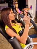 Girls workout on leg press in sport gym. Group girls workout on leg press in sport gym royalty free stock photography