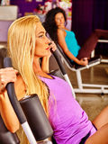 Girls workout on leg press in sport gym Stock Image