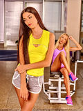 Girls workout and rest in sport gym Royalty Free Stock Photos