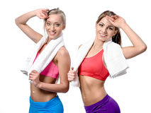 Girls after workout with towels Royalty Free Stock Images
