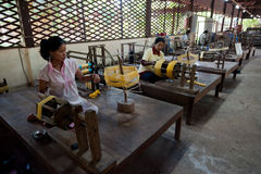 Girls works on silk factory Stock Photography