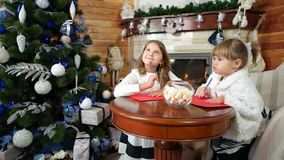Girls write letters to santa, magic christmas time, wishes come true, kids visit santa claus stock video