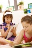 Girls writing homework Stock Photos