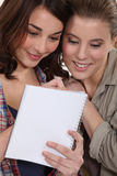 Girls writing on a notebook Royalty Free Stock Photo