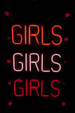 Girls written in neon lights against black background Stock Images