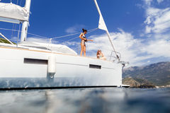 Girls yachting and photograph sea cruise vacation Stock Photos