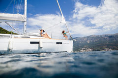 Girls yachting and photograph sea cruise vacation Royalty Free Stock Images
