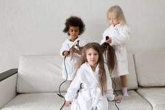 Hair care in children. Baby hairstyles stock photography