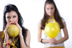 Girls with yellow balloon and fruit Royalty Free Stock Images