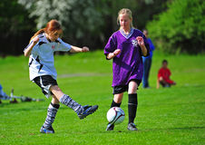 Girls Youth soccer kick Stock Photo