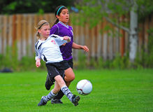 Girls Youth soccer kick Royalty Free Stock Image