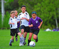 Girls Youth soccer kick royalty free stock images