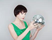Girlsholding a disco ball Stock Photos