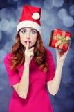 Girlwith gift. Stock Image