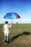 Girlwith umbrella at field. Girl with umbrella at green field Royalty Free Stock Photo