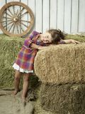 Girlwithhay. Little girl with hay in the country style Royalty Free Stock Photos