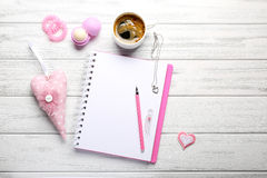 Girly accessories with blank notebook and cup of coffee on white Stock Photos