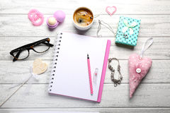 Girly accessories with notebook, cup of coffee and gift box on w Royalty Free Stock Images