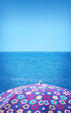 Girly beach umbrella Stock Photos