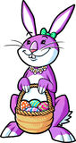 Girly bunny holding basket. Purple easter bunny holding basket with decorated eggs Stock Image