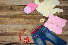 Girly clothing and accessories jeans, blouse, hat, hair clips, beads and warm vest Royalty Free Stock Images