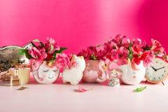 Girly Desk table or Office settings. Back to school concept. Different Notebooks, alarm clock, unicorn mug, llama squishy, Alstroemeria flowers and flamingo mug stock photography