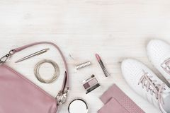Girly fashionable spring and summer accessories on pastel wooden background.  royalty free stock photos