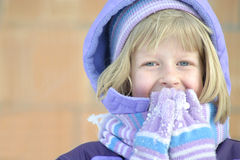 Girly Giggle. A sweet, shy young girl giggles in the winter air Stock Photos