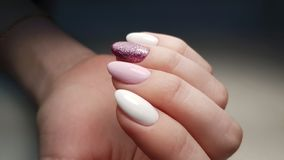 Girly nails pink and white. Nails, gel polish, art, oval, hand, cat nails, macro photo, clean machine manicure, pink, girly, glitter, glamorous, Russian manicure stock images