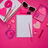 Girly pink desktop and stationery Royalty Free Stock Photo