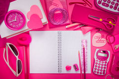 Girly pink desktop and stationery Royalty Free Stock Photos