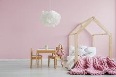 Girly scandi room. With wooden house bed Stock Photo
