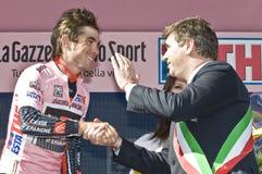 Giro d'Italia: Adriano Paroli and David Arroyo. Adriano Paroli, mayor of Brescia, rewards the pink shirt David Arroyo with a handshake Royalty Free Stock Photo