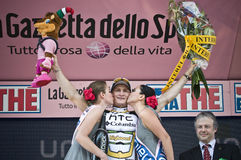 Giro d'Italia: Andre Greipel wins in Brescia. Andre Greipel (Columbia Highroad Team) wins the run in Brescia. Two beautiful girls are kissing him during the Stock Images