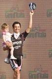 Giro d'Italia: Gilberto Simoni. Gilberto Simoni, famous cyclist, says goodbye to his fans, in the last day of his professional career, with his daughter Stock Photos