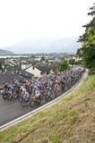 Giro d'Italia near Caldonazzo Lake. Cyclists of Giro d'Italia running near Caldonazzo Lake (Lago di Caldonazzo), in Levico Terme - Brescia stage Stock Images