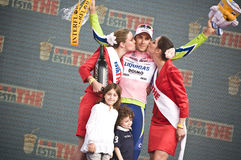 Giro d'Italia: victory of Ivan Basso. Ivan Basso is the winner of Giro d'Italia. Two beautiful girls are kissing him, and his children are not so happy Royalty Free Stock Images