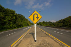 Giro de 180 grados Roadsign Foto de archivo libre de regalías