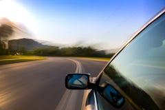 Giro dell'automobile sulla strada Immagini Stock Libere da Diritti