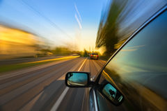 Giro dell'automobile sulla strada Immagine Stock Libera da Diritti
