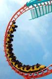 Giro delle montagne russe in parco di divertimenti Immagini Stock Libere da Diritti
