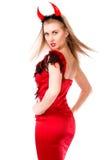 Giro em torno da jovem mulher em um traje do diabo Fotografia de Stock