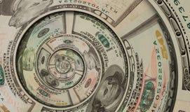 Giro espiral de los dólares de EE. UU. del dinero hecho de cientos cincuenta diez dólares de billetes de banco Dólares de EE. UU. Fotografía de archivo libre de regalías